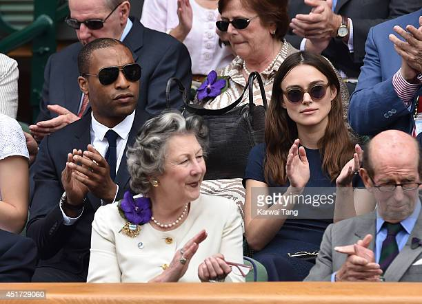 Chiwetel Ejiofor and Keira Knightley attend the ladies singles final between Eugenie Bouchard and Petra Kvitova on centre court during day twelve of...