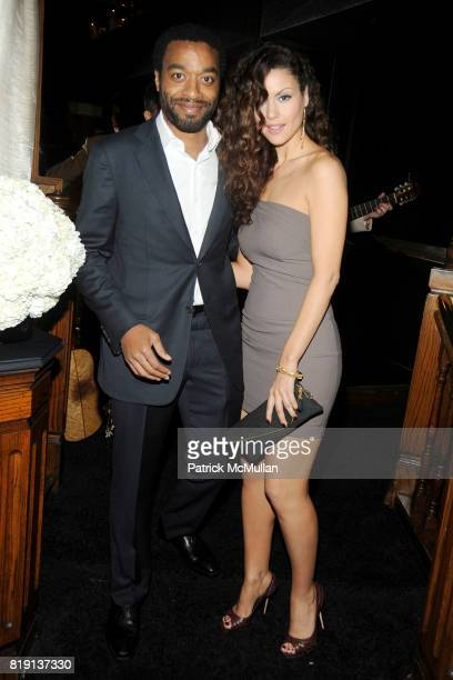 Chiwetel Ejiofor and Lisa Marcos attend CHANEL and CHARLES FINCH Pre-Oscar Dinner at Madeo Restaurant on March 6, 2010 in Beverly Hills, California.