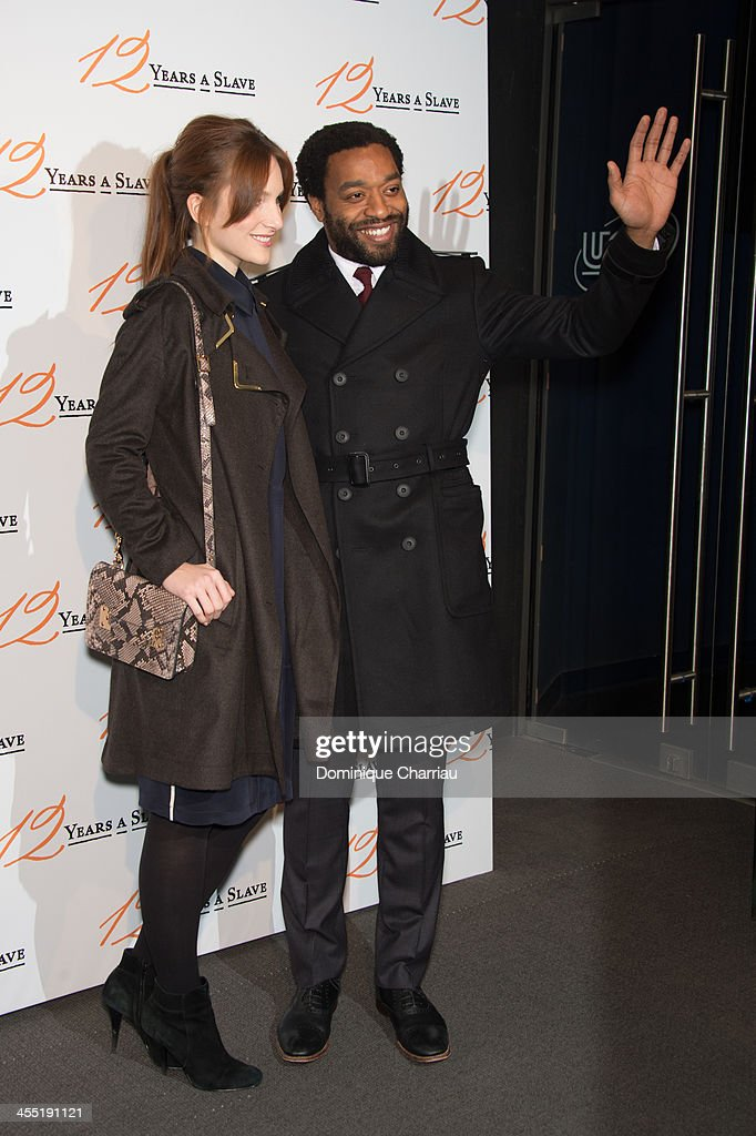 Chiwetel Ejiofor (R ) and Sari Mercer attend the '12 Years A Slave' Paris premiere at Cinema UGC Normandie on December 11, 2013 in Paris, France.