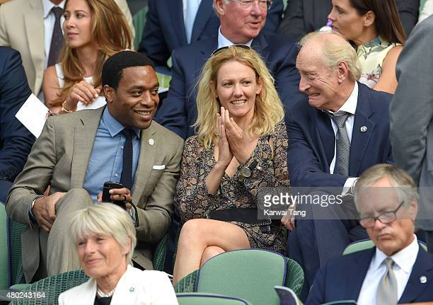 Chiwetel Ejiofor Jennifer Barrons and Charles Dance attend day eleven of the Wimbledon Tennis Championships at Wimbledon on July 10 2015 in London...