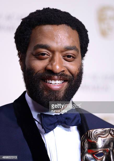 Chiwetel Ejiofor poses in the winners room at the EE British Academy Film Awards 2014 at The Royal Opera House on February 16 2014 in London England