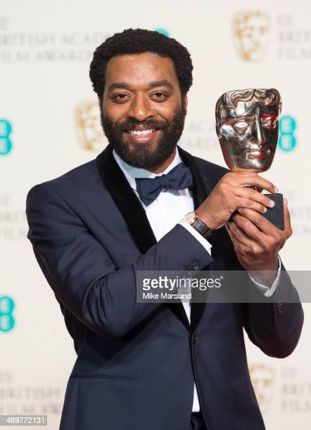 Chiwetel Ejiofor poses with his Best Actor award in the winners room at the EE British Academy Film Awards 2014 at The Royal Opera House on February...