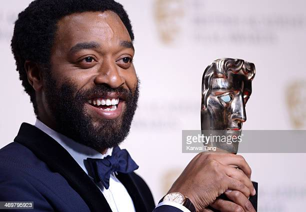 Chiwetel Ejiofor winner of the best actor award poses in the winners room at the EE British Academy Film Awards 2014 at The Royal Opera House on...