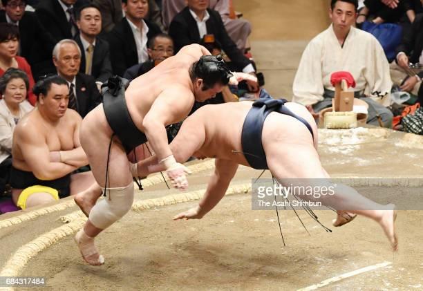 Chiyonokuni throws Mongolian yokozuna Kakuryu to win during day two of the Grandu Sumo Summer Tournament at Ryogoku Kokugikan on May 15 2017 in Tokyo...