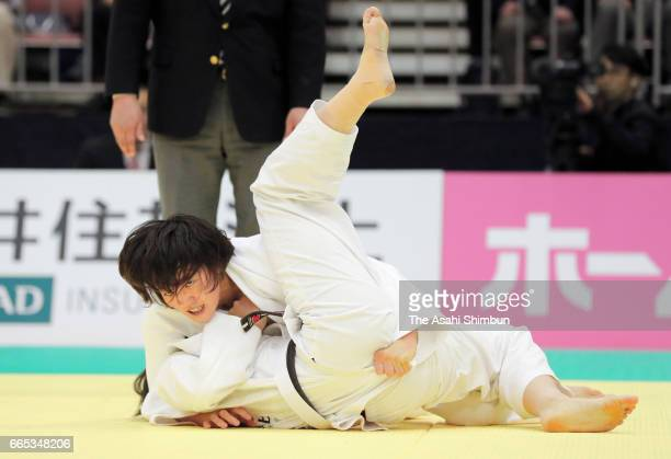 Chizuru Arai holds Saki Niizoe to win by ippon in the Women's 70kg final during day one of the All Japan Invitational Judo Championships By Weight...