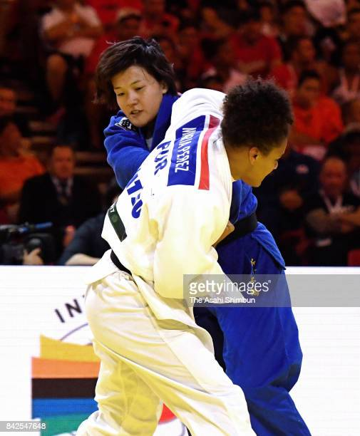 Chizuru Arai of Japan and Maria Perez of Pierto Rico compete in the Women's 70kg final during day five of the World Judo Championships at the Laszlo...