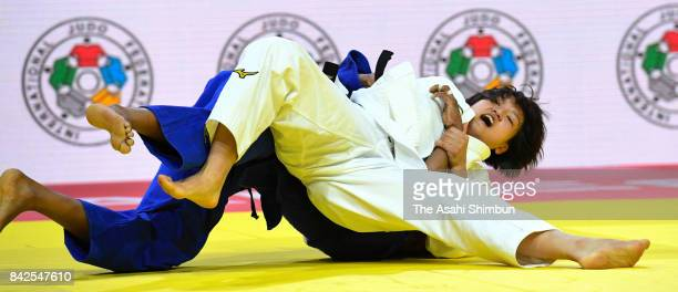 Chizuru Arai of Japan and Yuri Alvear of Colombia compete in the Women's 70kg semi final during day five of the World Judo Championships at the...