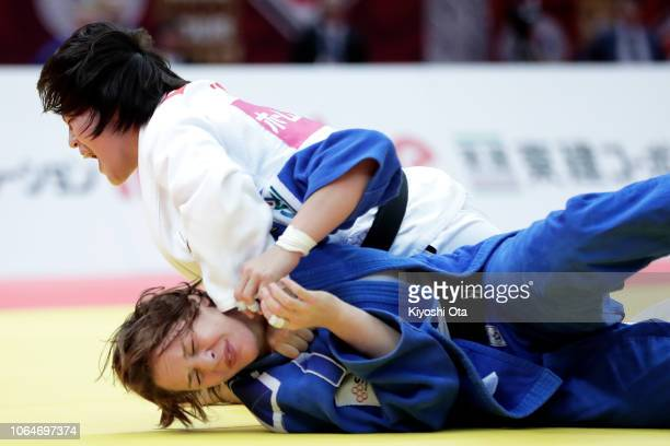 Chizuru Arai of Japan competes against Margaux Pinot of France in the Women's 70kg semifinal match on day two of the Grand Slam Osaka at Maruzen...