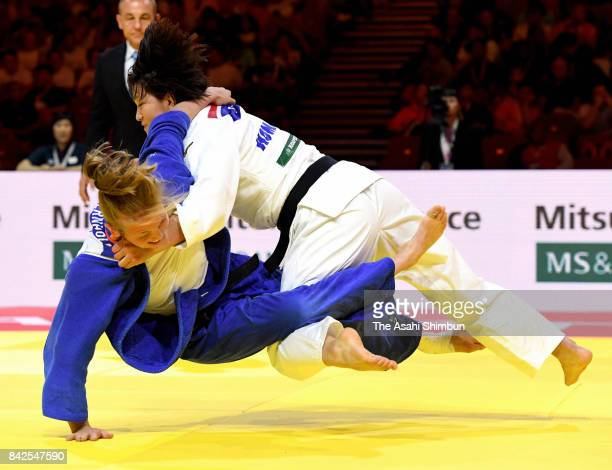 Chizuru Arai of Japan throws Anna Bernholm of Sweden in the Women's 70kg second round during day five of the World Judo Championships at the Laszlo...