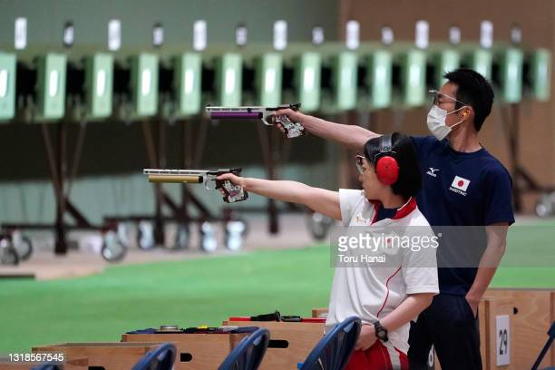 Chizuru Sasaki and Kojiro Horimizu of Japan compete in the qualifying round for the 10m Air Pistol Mixed Team during the Shooting Olympic test event...