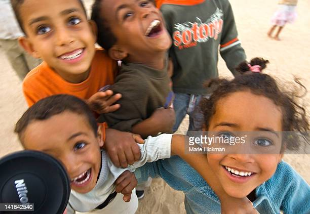 chlidren outside brides house during a wedding procession in old part of nefta, tunisia - nikon stock pictures, royalty-free photos & images