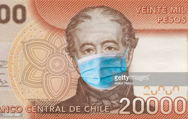 chlie quarantine, 20000 pesos banknote with medical mask. the concept of epidemic and protection against coronavrius. - chile stock pictures, royalty-free photos & images