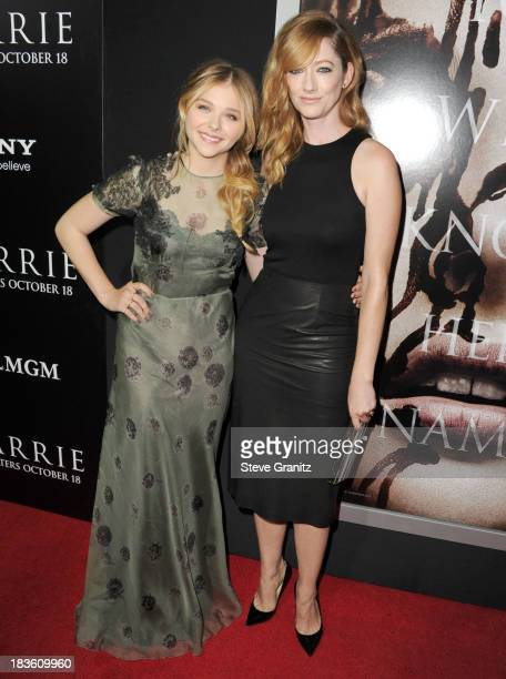 Chlo Grace Moretz and Judy Greer arrives at the Carrie Los Angeles Premiere at ArcLight Hollywood on October 7 2013 in Hollywood California