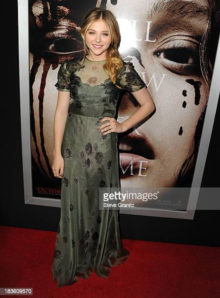 Chlo Grace Moretz arrives at the Carrie Los Angeles Premiere at ArcLight Hollywood on October 7 2013 in Hollywood California