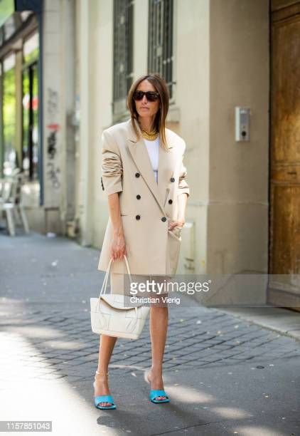 Chloé Harrouche is seen wearing beige blazer shorts white bag blue sandals outside Lanvin during Paris Fashion Week Menswear Spring/Summer 2020 on...