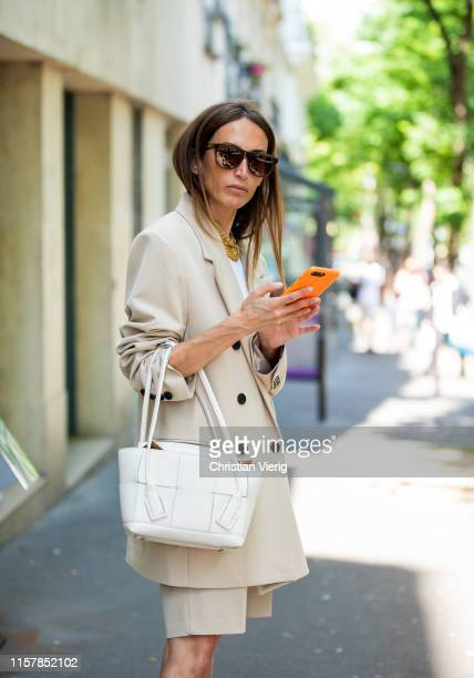 Chloé Harrouche is seen wearing beige blazer, shorts, white bag outside Lanvin during Paris Fashion Week - Menswear Spring/Summer 2020 on June 23,...