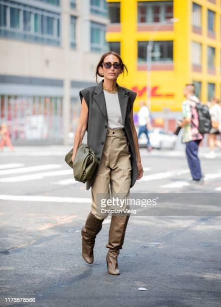 Chloé Harrouche is seen wearing boots, beige pants, sleeveless blazer vest outside Zimmermann during New York Fashion Week September 2019 on...