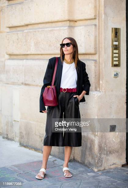 Chloé Harrouche is seen wearing cropped black pants blazer outside RVDK Ronald Van Der Kemp during Paris Fashion Week Haute Couture Fall/Winter...