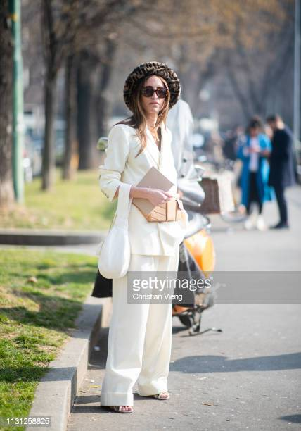 Chloé Harrouche is seen wearing hat white suit with wide leg pants outside Fendi on Day 2 Milan Fashion Week Autumn/Winter 2019/20 on February 21...