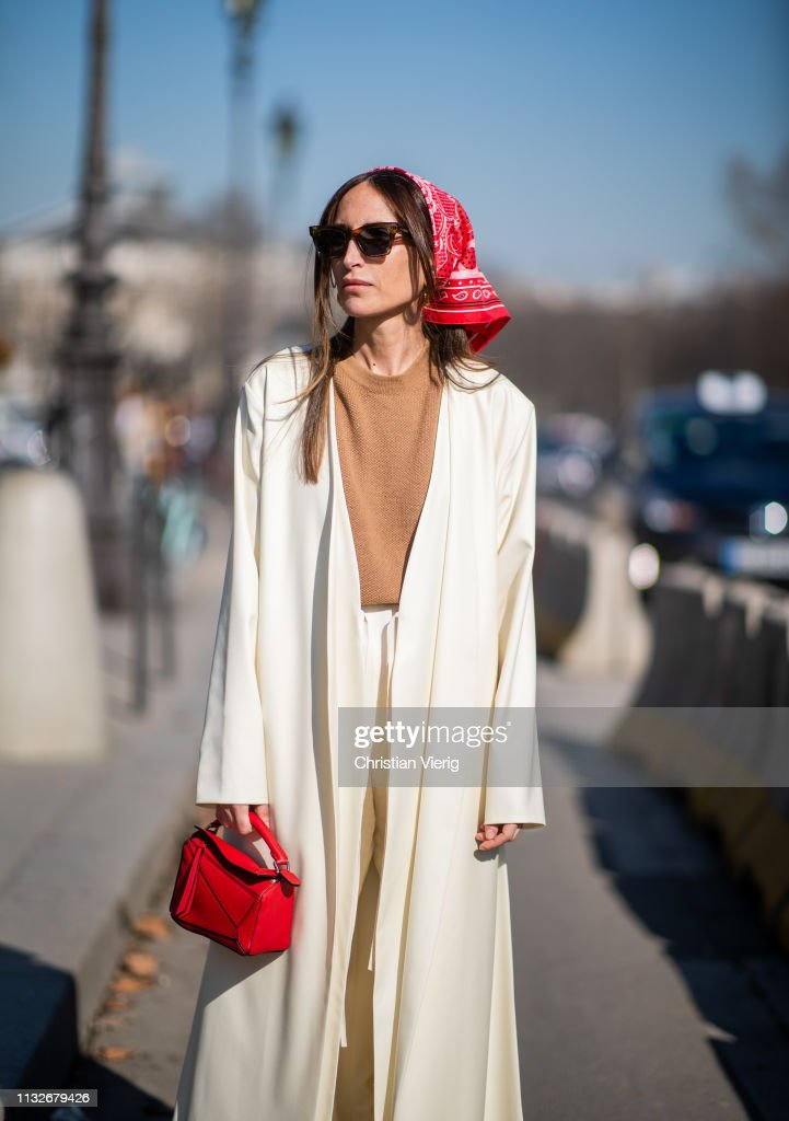 Chloé Harrouche is seen wearing head scarf, creme white coat