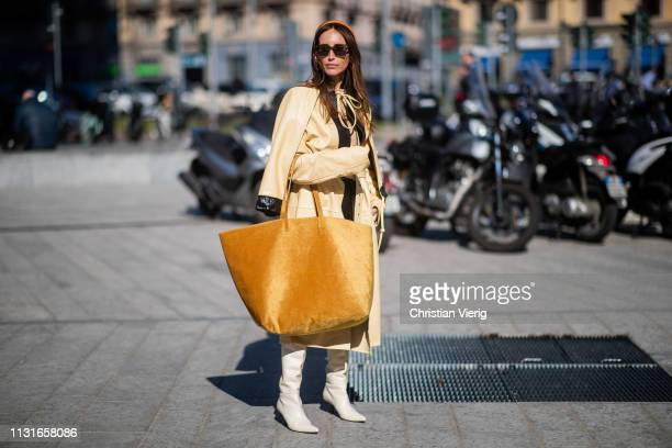 Chloé Harrouche is seen wearing oversized velvet bag yellow belted coat outside Sportmax on Day 3 Milan Fashion Week Autumn/Winter 2019/20 on...