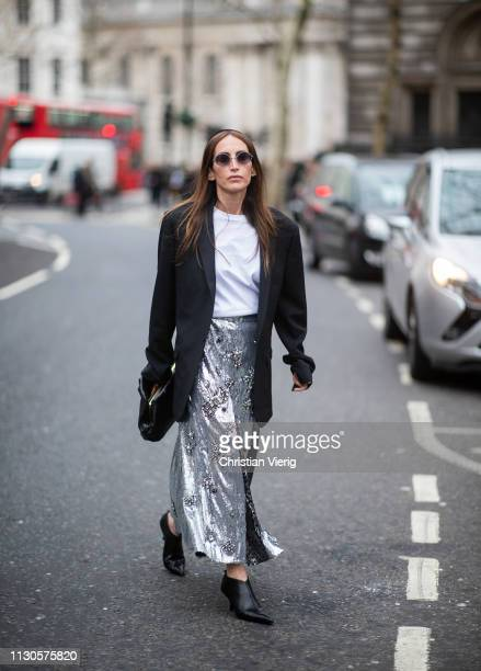 Chloé Harrouche is seen wearing silver skirt outside Erdem during London Fashion Week February 2019 on February 18 2019 in London England