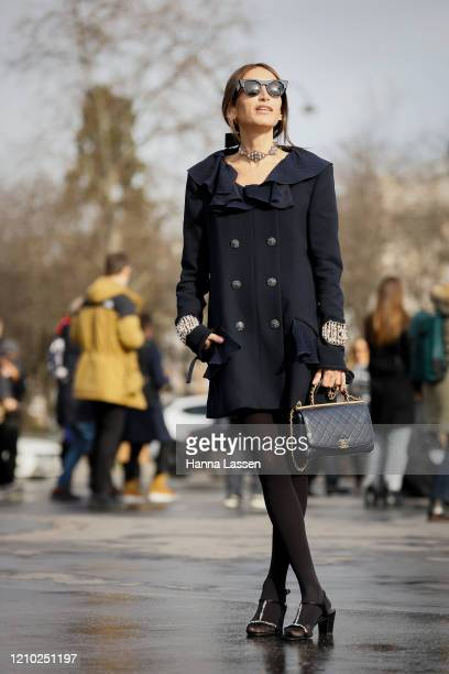Chloé Harrouche wearing Chanel dress, Chanel bag, Chanel necklace and Tol sunglasses outside the Chanel show during Paris Fashion Week Womenswear...
