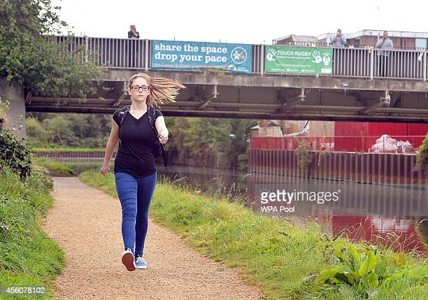 Chloe a 17yearold police cadet walks along the towpath after walking under the Trumpers Way Bridge as she reconstructs the last known movements of...