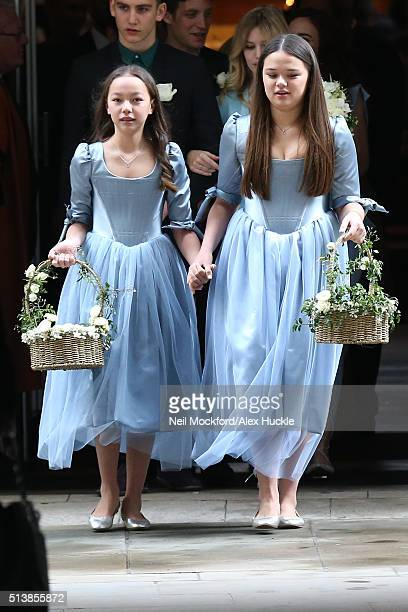 Chloe and Grace Helen Murdoch leave St Brides Church after the wedding of Jerry Hall and Rupert Murdoch on March 5 2016 in London England