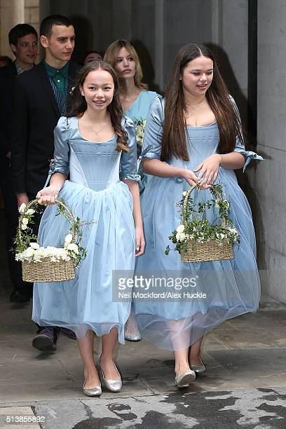 Chloe and Grace Helen Murdoch leave St Brides Church followed by Gabriel Jagger and Georgia May Jagger after the wedding of Jerry Hall and Rupert...