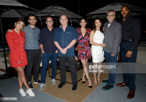 """Chloe Bennet, Jeff Ward, Clark Gregg, Jeph Loeb, Natalia Cordova-Buckley, Ming-Na Wen, Jeff Bell, and Henry Simmons attend an """"After Dark"""" Party,..."""