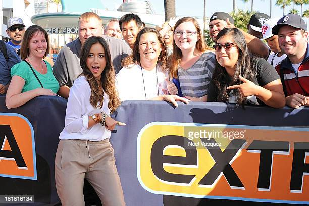 Chloe Bennet takes pictures with fans at Extra at Universal Studios Hollywood on September 25 2013 in Universal City California
