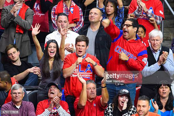 Chloe Bridges Adam DeVine and Erik Griffin attend a basketball game between the San Antonio Spurs and the Los Angeles Clippers at Staples Center on...