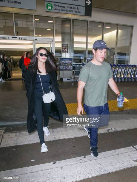 Chloe Bridges and Adam DeVine are seen at Los Angeles International Airport on April 20 2018 in Los Angeles California