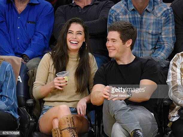 Chloe Bridges and Adam DeVine attend a basketball game between the New York Knicks and the Los Angeles Lakers at Staples Center on December 11 2016...