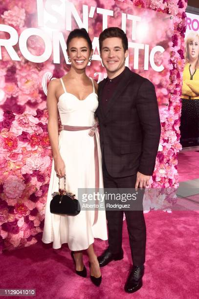 Chloe Bridges and Adam DeVine attend the premiere of Warner Bros Pictures' 'Isn't It Romantic' at The Theatre at Ace Hotel on February 11 2019 in Los...