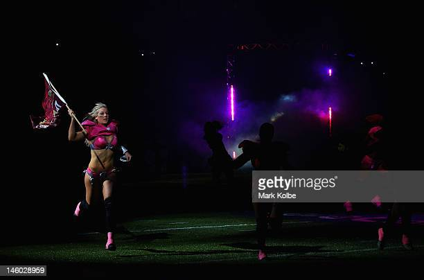 Chloe Bulter of the Western Conference QLD Reds enters the arena during game two of the AllStar Lingerie Football League tour at Allphones Arena on...