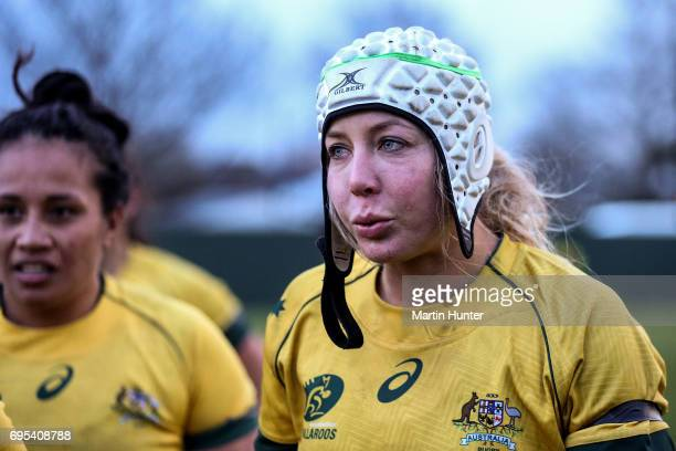 Chloe Butler of Australia reacts to the cold weather during the International Women's Test match between the New Zealand Silver Ferns and the...