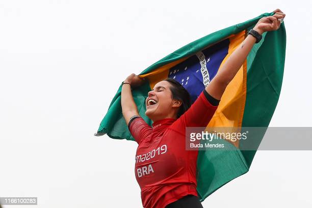 Chloe Calmon of Brazil celebrates after winning the gold medal in Women's Longboard Final at Punta Rocas Beach on Day 9 of Lima 2019 Pan American...