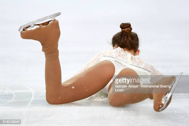 Chloe Curtin from Great Britain falls during her show with his couple Steven Adcock at the Pair«s Free Skating program of the ISU World Junior Figure...