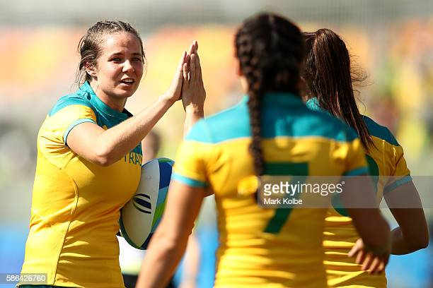Chloe Dalton of Australia congratulates her team mates after a try during the Women's Pool A rugby match between Ausutralia and Colombia on Day 1 of...