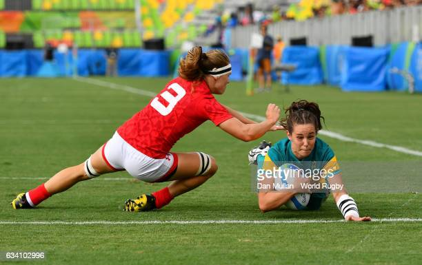 Chloe Dalton of Australia dives over for a try during the Women's Rugby Sevens Semi Final match between Australia and Canada on day 3 of the Rio 2016...