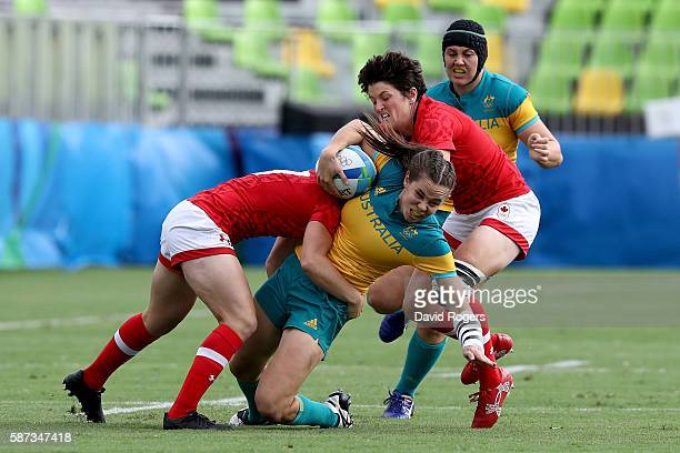 Chloe Dalton of Australia gets tackled by Ghislaine Landry of Canada during the Women's Semi Final 1 Rugby Sevens match between Australia and Canada...