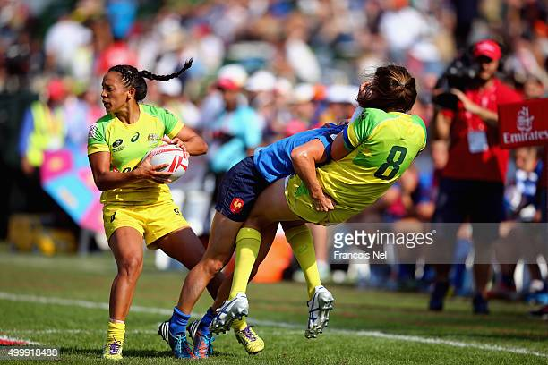 Chloe Dalton of Australia is tackled by Audrey Amiel of France during the Emirates Dubai Rugby Sevens HSBC World Rugby Women's Sevens Series on...
