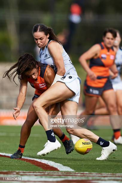 Chloe Dalton of Carlton and Amanda Farrugia of the Giants contest the ball during the round three AFLW match between the Greater Western Sydney...