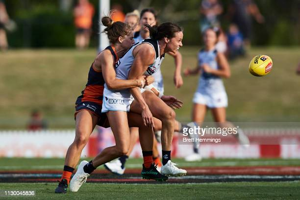 Chloe Dalton of Carlton is tackled during the round three AFLW match between the Greater Western Sydney Giants and the Carlton Blues at Blacktown...