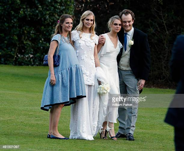 Chloe Delevingne Poppy Delevingne and Cara Delevingne seen at Poppy Delevingnes wedding held in Kensington Palace Gardens on May 16 2014 in London...