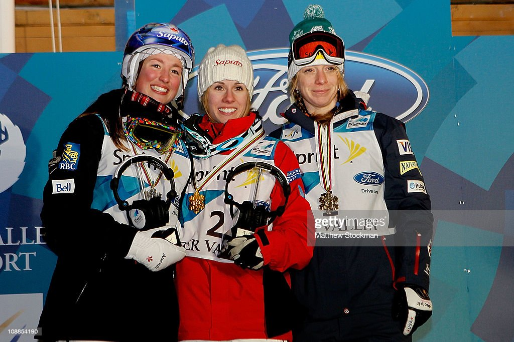 Chloe Dufour-Lapointe of Canada, Jennifer Heil of Canada and Hannah Kearney pose for photographers on the winners podium after the ladies' Dual Moguls final at the FIS Freestyle World Championships at Deer Valley Resort on February 5, 2011 in Park City, Utah.
