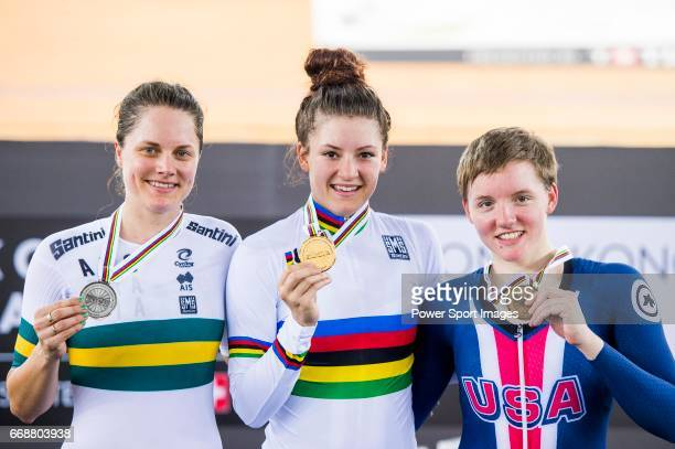 Chloe Dygert of USA celebrates winning in the Women's Individual Pursuit's prize ceremony with Ashlee Ankudinoff of Australia and Kelly Catlin of USA...