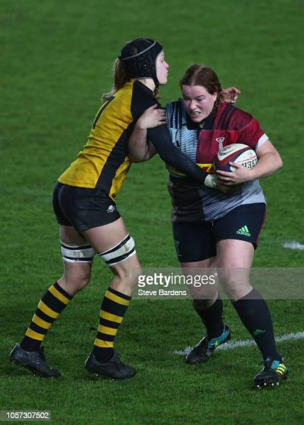 Chloe Edwards of Harlequins Ladies is tackled by Alice Sheffield of Wasps FC Ladies during the Tyrells Premier 15s match between Harlequins Ladies...